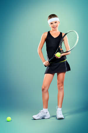 Portrait of a girl tennis player holding tennis racket and tennis ball. Studio shot.  Stock Photo - 16742367