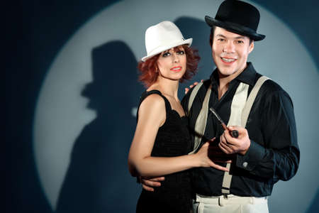 Couple of professional artist in retro style posing in costumes at studio. photo