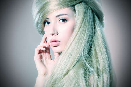 Beautiful blonde woman with fashionable hairstyle.  photo