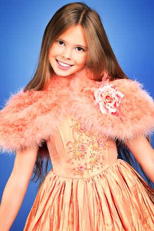 Beautiful little girl in festive dress posing at studio. Stock Photo - 16711683