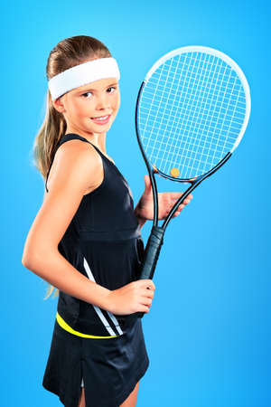 Portrait of a girl tennis player holding tennis racket. Studio shot.  Stock Photo - 16711696