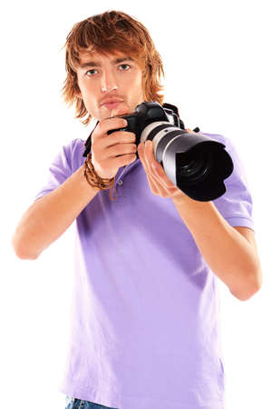 Handsome young man taking pictures on the camera. Isolated over white. photo