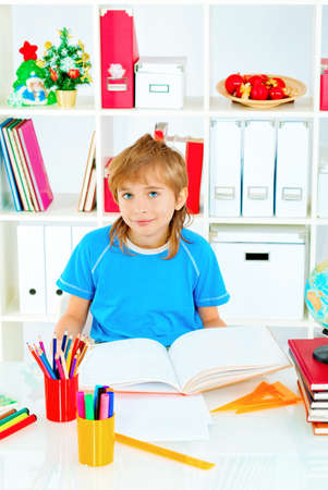 A boy doing his lessons at home. Stock Photo - 16763825