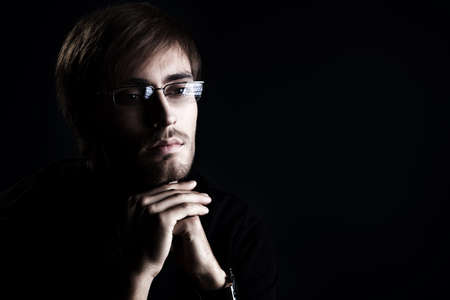 Portrait of a handsome man over black background. Stock Photo - 16890631