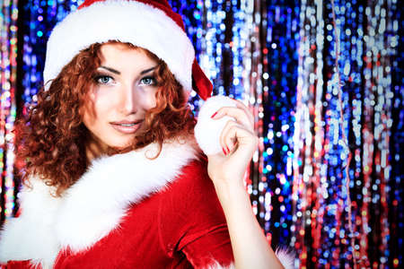 Attractive young woman in Christmas clothes on a party. Disco lights in the background. Stock Photo - 16763838