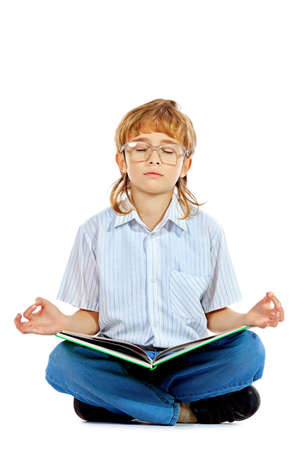 A boy is meditating with his book. Isolated over white background.