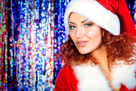 Attractive young woman in Christmas clothes on a party. Disco lights in the background. Stock Photo - 16763808
