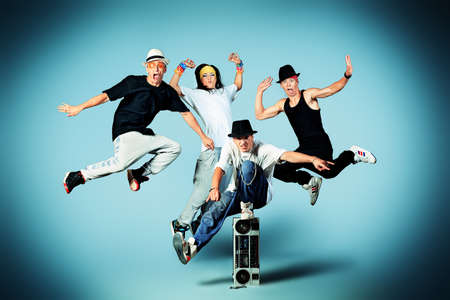 Group of modern dancers dancing hip-hop at studio. Stock Photo - 16859608