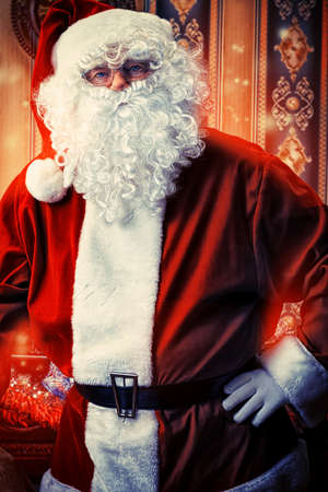 nick: Portrait of a fairy Santa Claus at home.