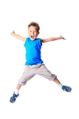 leaping: Happy boy is jumping at studio. Stock Photo