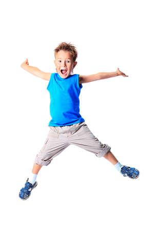 saltando: Ni�o feliz est� saltando en el estudio. Foto de archivo