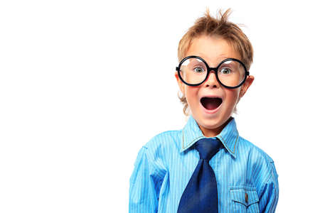 cool boy: Portrait of a surprised little boy in spectacles and suit. Isolated over white background.