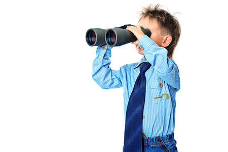 Curious little boy is looking through binoculars. Isolated over white background. Stock Photo - 16826366