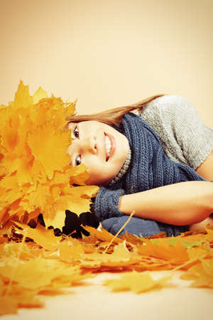 Portrait of a smiling girl in autumn clothes and a hat of maple leaves Stock Photo - 16846195