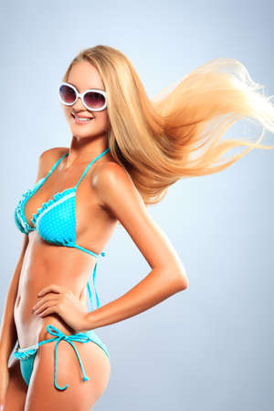 Portrait of a romantic young woman in bikini with streaming hair. Studio shot. Stock Photo - 16884176