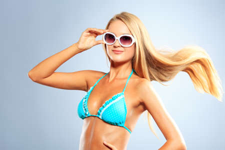 Portrait of a romantic young woman in bikini with streaming hair. Studio shot. Stock Photo - 16884206
