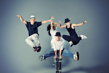 hip hop dance: Group of modern dancers dancing hip-hop at studio. Stock Photo