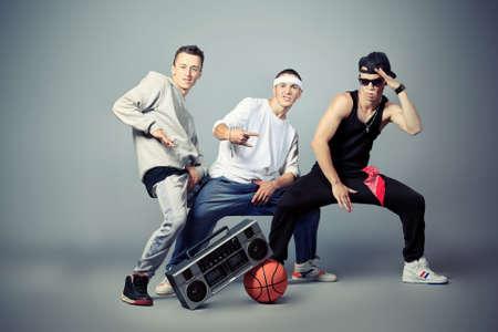 Group of trendy teenagers dancing hip-hop at studio. photo