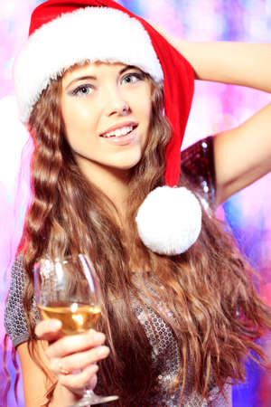 Pretty girl in Christmas clothes on a party. Disco lights in the background. Stock Photo - 16940492