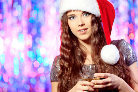 Pretty girl in Christmas clothes on a party. Disco lights in the background. Stock Photo - 16940511
