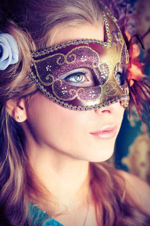 carnival mask: Portrait of a beautiful young woman in a carnival mask. Vintage style. Stock Photo