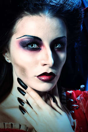 the claws: Portrait of a beautiful female vampire.