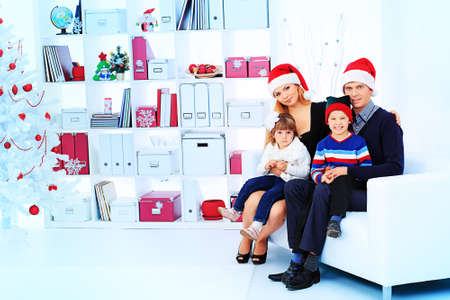 Portrait of a happy family spending Christmas time at home. Stock Photo - 17038898