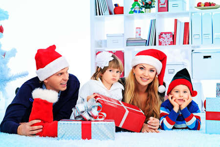 Portrait of a happy family spending Christmas time at home. Stock Photo - 17038908