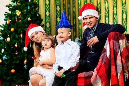 Portrait of a happy family spending Christmas time at home. Stock Photo - 17038901