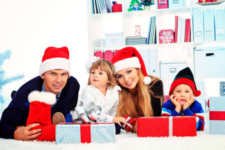 Portrait of a happy family spending Christmas time at home. Stock Photo - 17038904