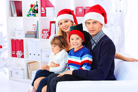 Portrait of a happy family spending Christmas time at home. Stock Photo - 17038905