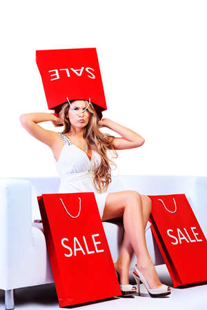 Happy blonde woman enjoying her shopping with shopping bags. Isolated over white. photo