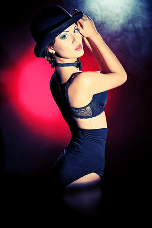 Art portrait of a gorgeous woman in black lingerie. Retro style.  Light and shadow. photo
