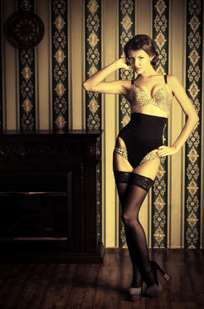 Seductive young woman in sexy lingerie posing in the vintage interior. Stock Photo - 17134116