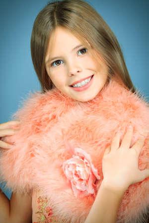 birthday angel: Beautiful little girl in festive dress posing at studio  Stock Photo