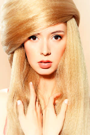 Beautiful blonde woman with fashionable hairstyle   photo