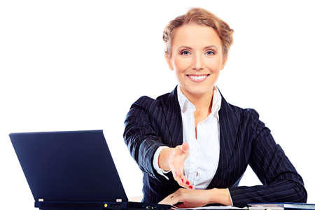 hands joined: Portrait of a smiling businesswoman working on a laptop. Isolated over white. Stock Photo