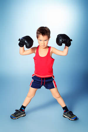 boy boxing: Portrait of a sporty boy engaged in boxing.