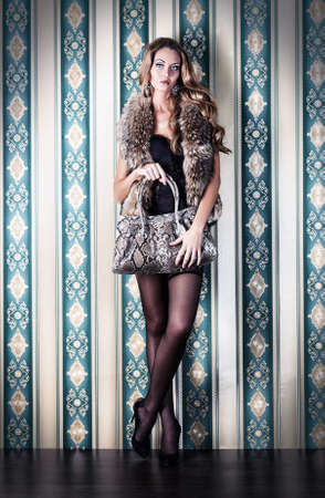 sexy stockings: Full length portrait of a sexual fashionable woman over vintage background.