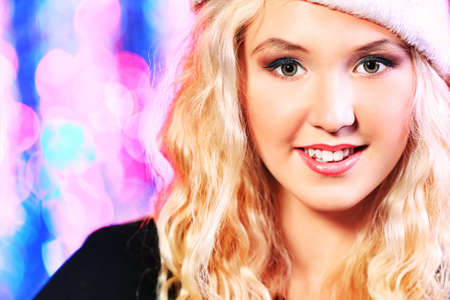 Pretty teenage girl in Christmas clothes on a party. Disco lights in the background. Stock Photo - 17234874