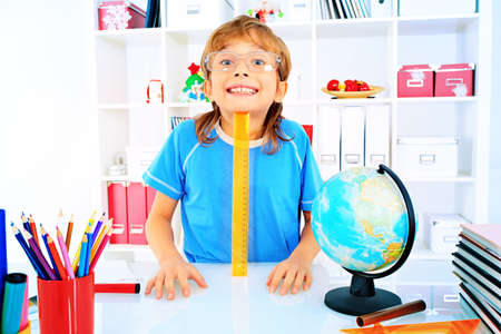 Funny boy doing his lessons at home. Stock Photo - 17231223