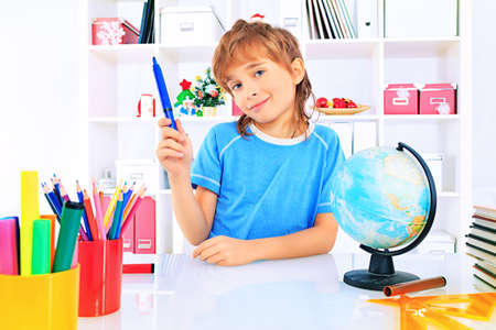 A boy doing his lessons at home. Stock Photo - 17231499