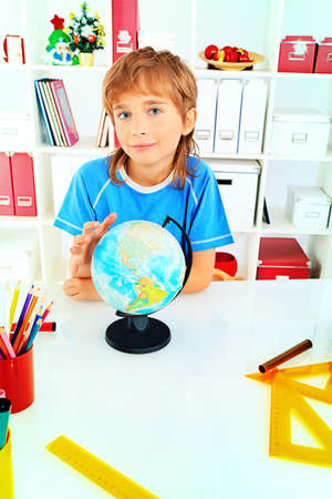 A boy doing his lessons at home. Stock Photo - 17231404
