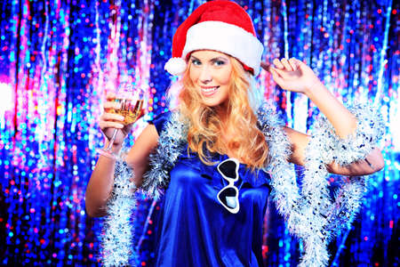 Pretty teenage girl in Christmas clothes on a party. Disco lights in the background. Stock Photo - 17234880
