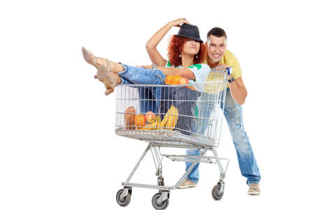Cheerful couple with a shopping trolley. Isolated over white background. Stock Photo - 17245133
