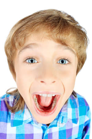 Portrait of a funny emotional 9 year boy. Isolated over white background. photo