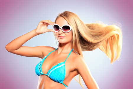 Portrait of a romantic young woman in bikini with streaming hair. Studio shot. Stock Photo - 17383352