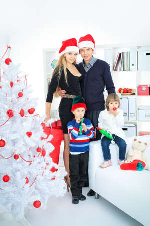 Portrait of a happy family spending Christmas time at home. photo