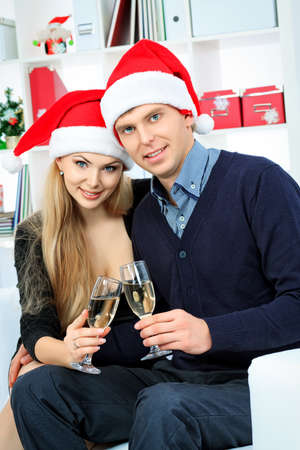 Happy young couple celebrating Christmas at home  photo