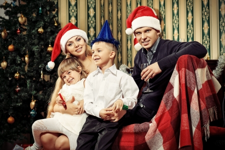 Portrait of a happy family spending Christmas time at home  photo